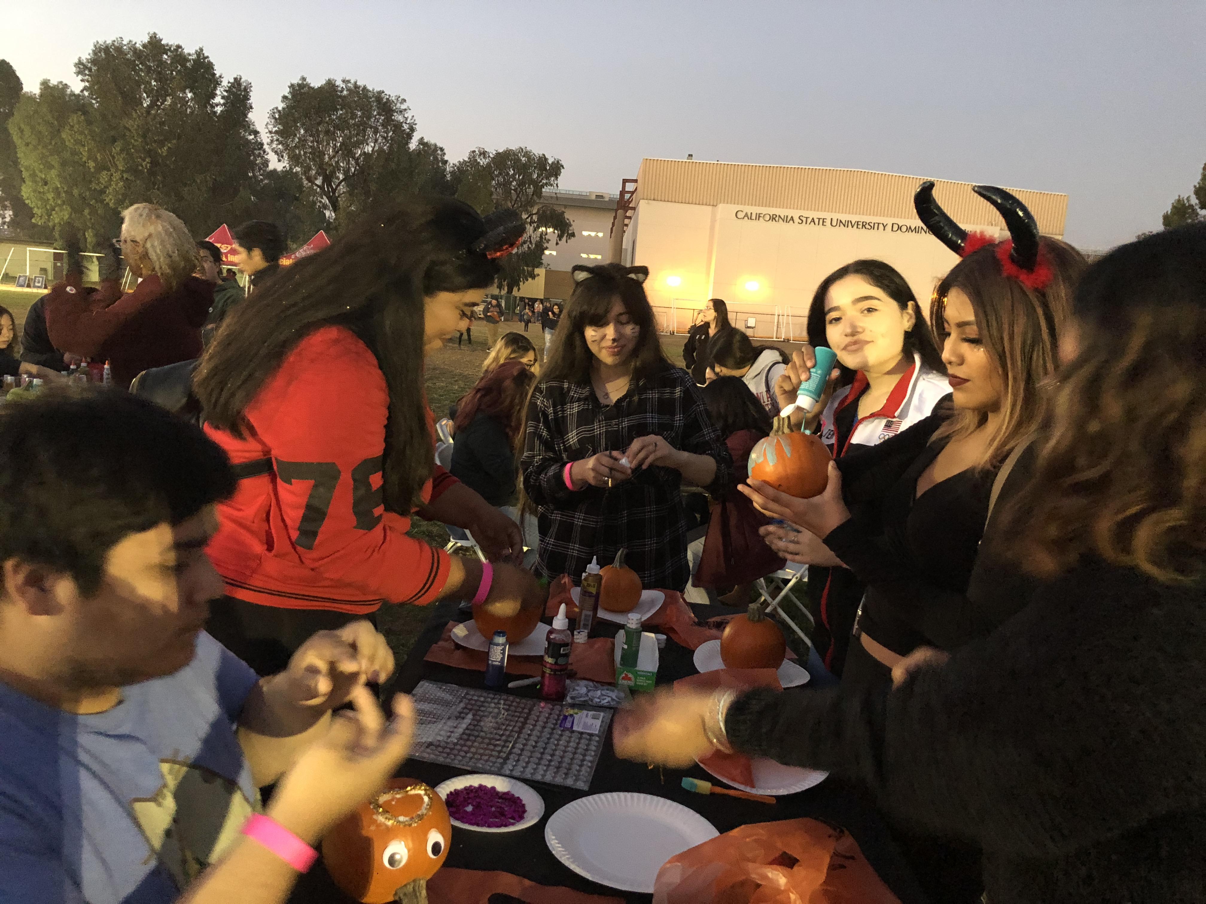 Halloween Haunt - Students Painting Pumpkins